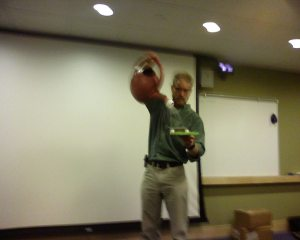 blurry cell phone picture of Brad Lancaster pouring water